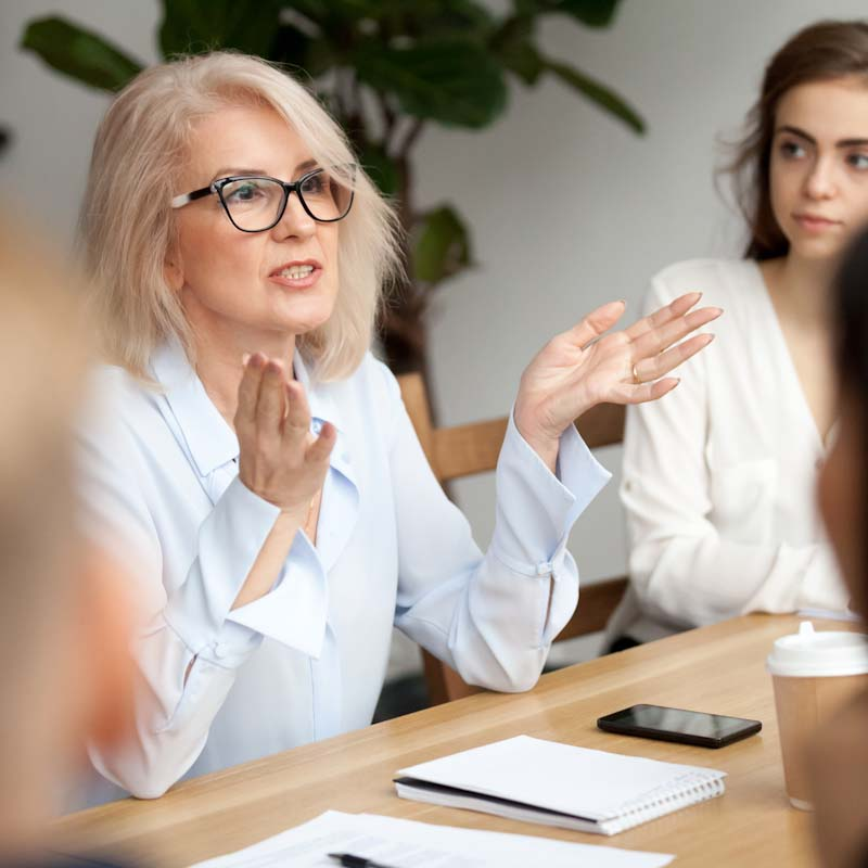 Woman speaks at business meeting
